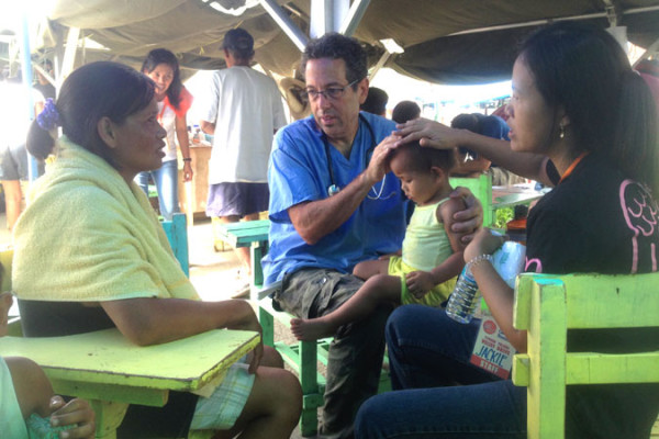 Andrew Lustig administers aid in Philippines