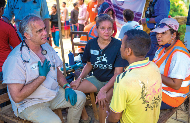 DR. MIKE KIERNAN of Weybridge, left, works with a patient in Nepal after the recent earthquake. Kiernan worked in Nepal for a week with other volunteer doctors, nurses and search dogs. Photo by Mike Morse
