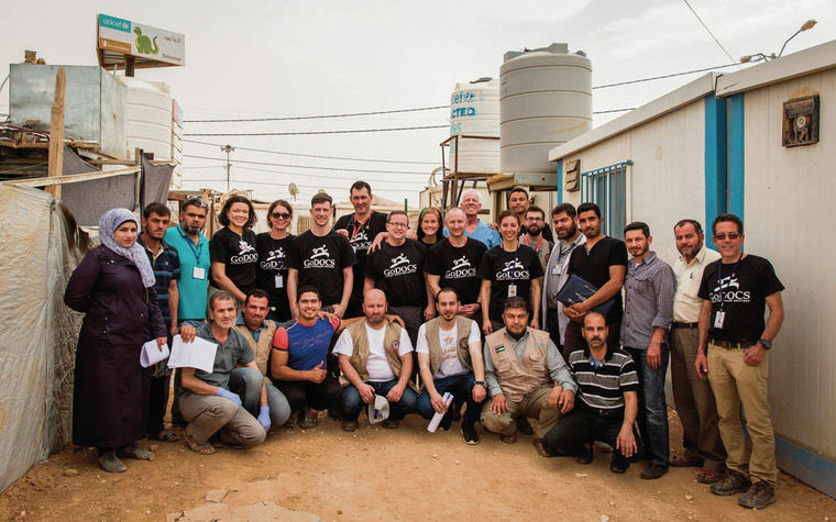 Andrew Lustig in Syria with the Global Outreach Doctors team at a refugee camp last month. Lustig founded the humanitarian organization in 2014 to respond to worldwide disasters. Courtesy Maranie Staab